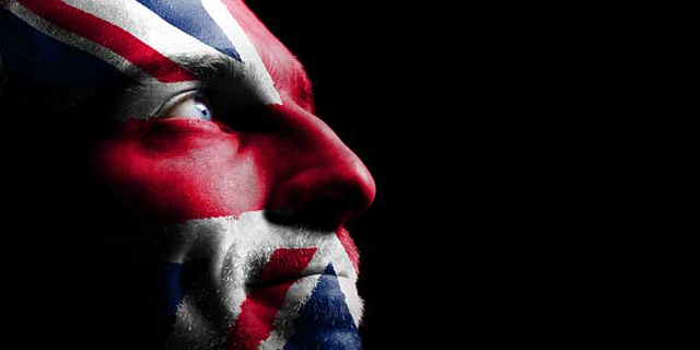 Fan face painted with British flag